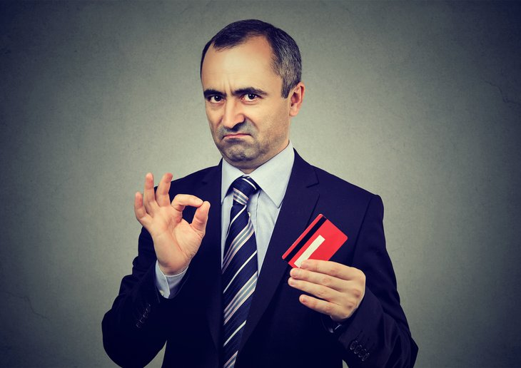 Scammer posing as a businessman with credit card