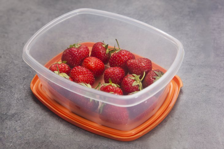 Strawberries in a plastic food storage container