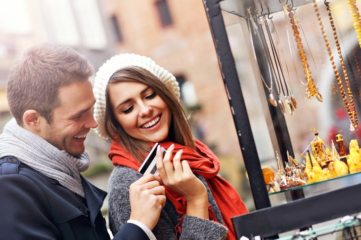 Couple with credit card, shopping.
