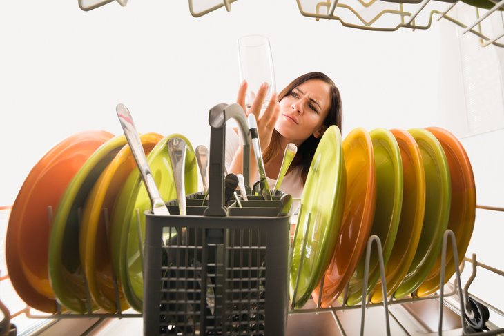 Woman looking in dishwasher