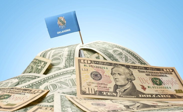 Pile of money with Oklahoma flag