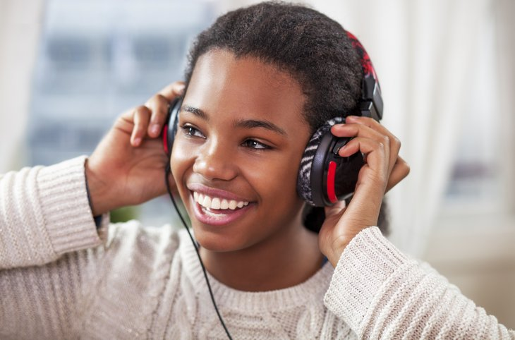Teen listening to music on headphones
