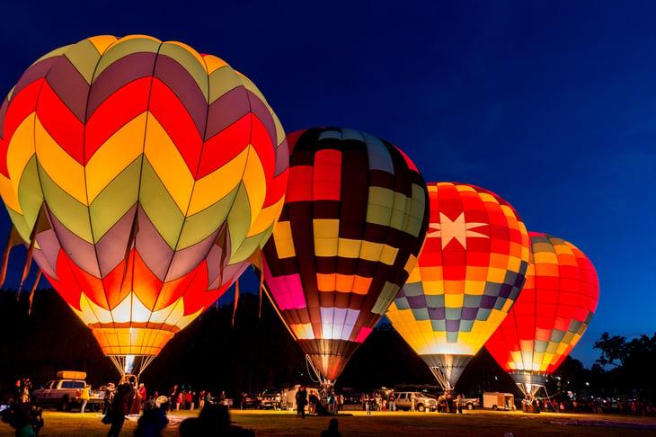 Hot air balloons at dawn.
