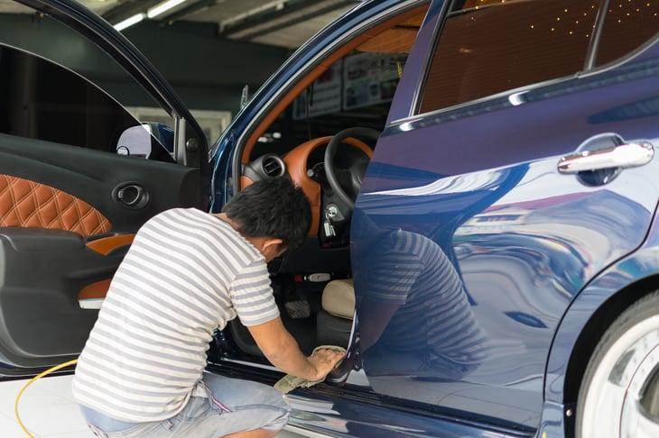 Man detailing car.