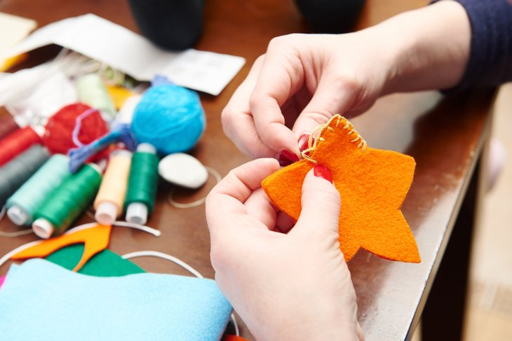 Hands making crafts