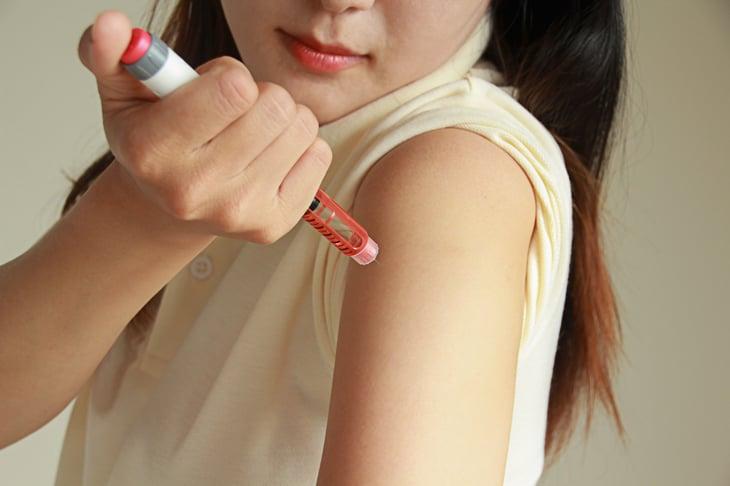 Woman self-injecting insulin