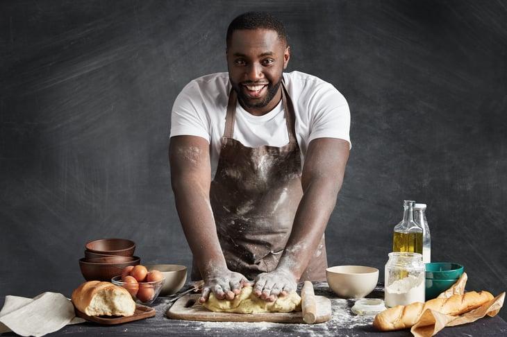 African American man baking.