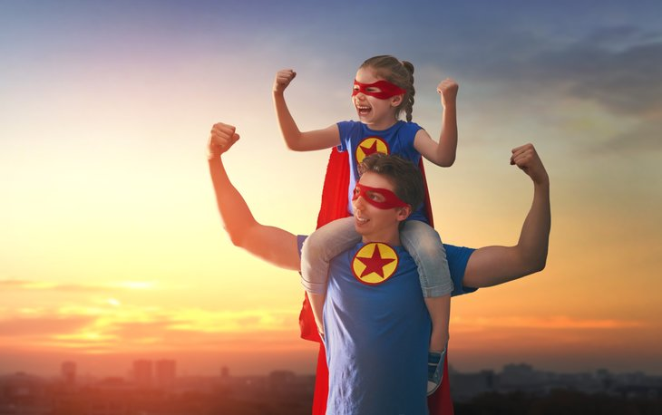 Father and daughter dressed as super heroes
