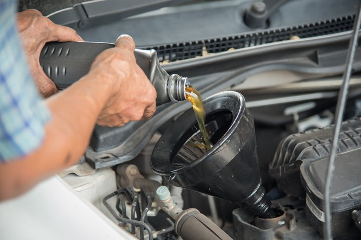 Man changing the motor oil in his car