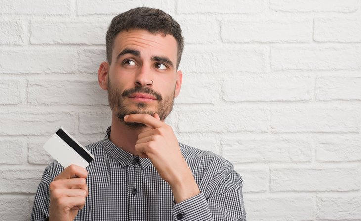 Man asking credit card questions