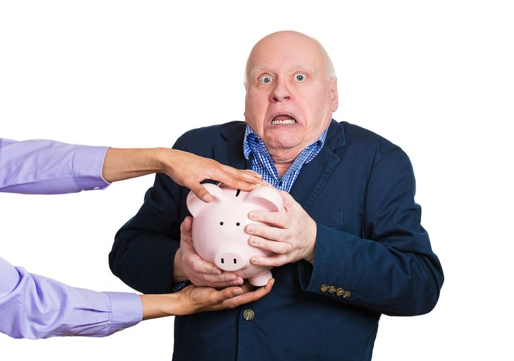 Shocked man with piggy bank