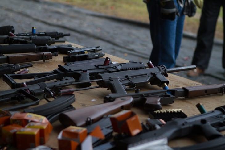 Guns on a table.