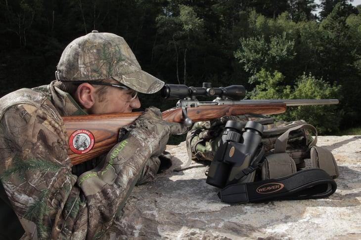 Hunter with Savage Arms brand rifle