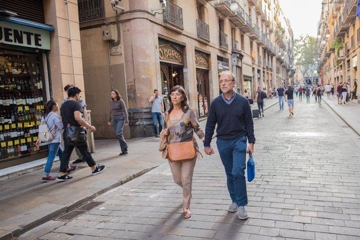Tourist couple walking on street in Europe.