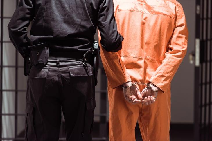 Prison guard with prisoner