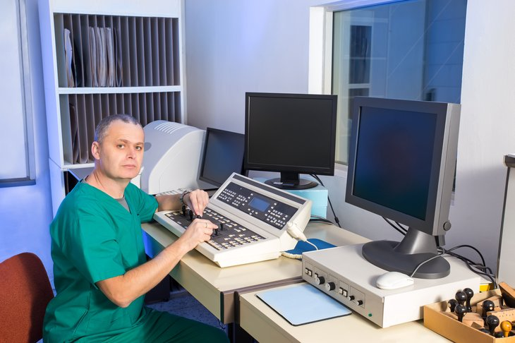 Radiation therapist in control room.