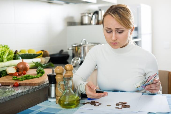 Sad woman with money