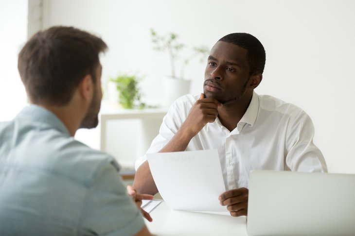 Serious attentive african american hr manager job interview thinking hiring listening office