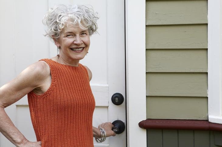 Senior woman outside home