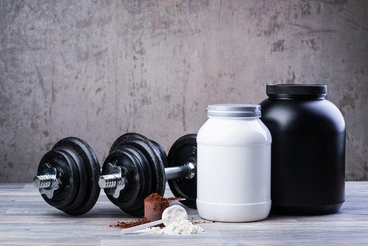 Dumbbells and jars of protein.