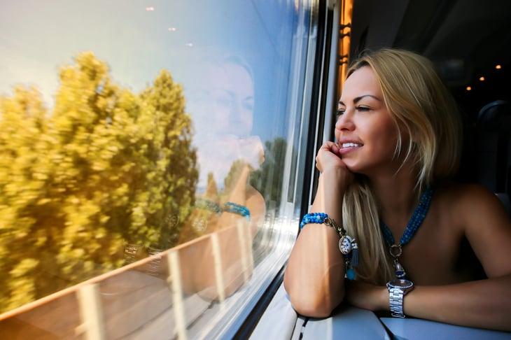 Girl sitting on a train