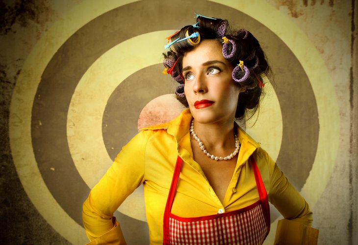 Housewife in curlers.