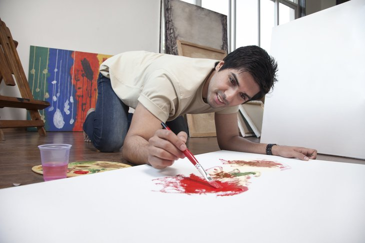 Man painting a picture.