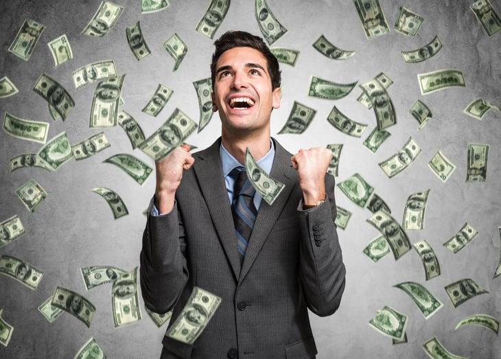 Rich, happy man with raining money