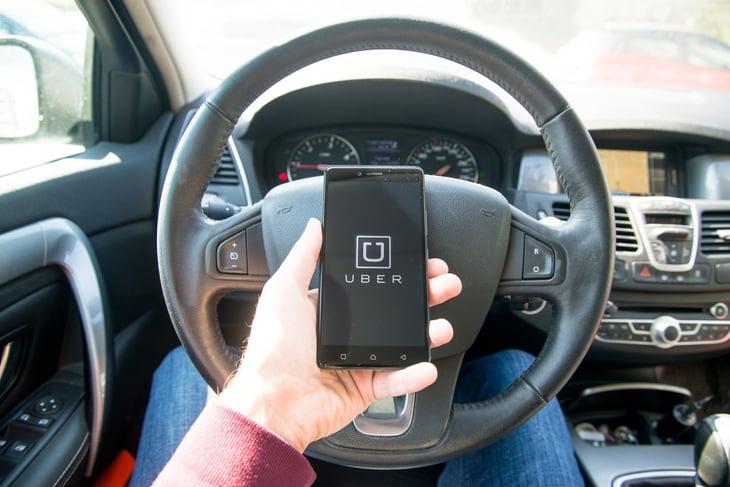 Uber driver using app.