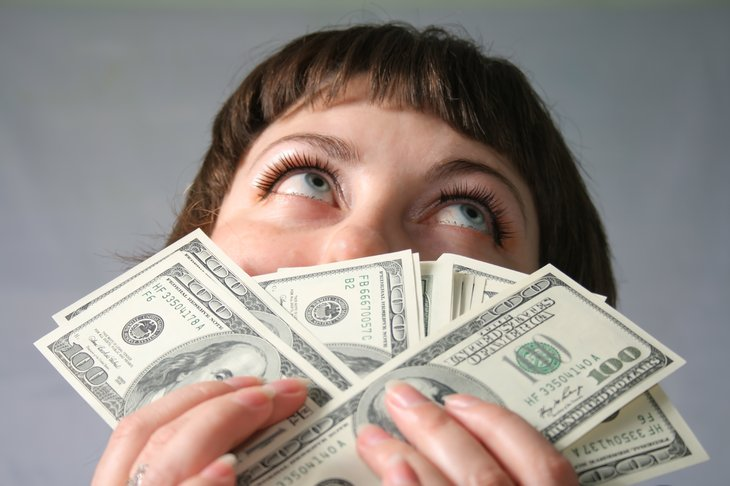 Woman with money, looking stupid