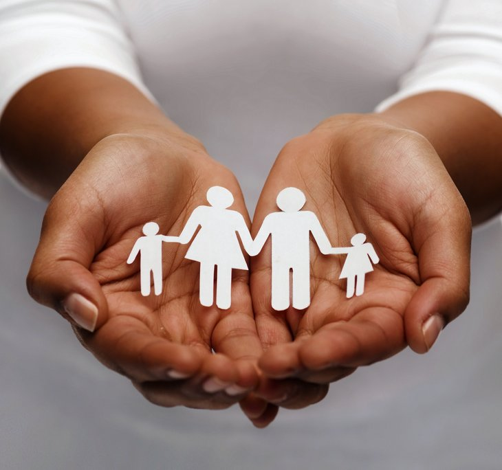 Hands holding paper cutouts