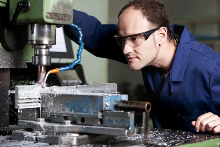 Metal worker at milling machine