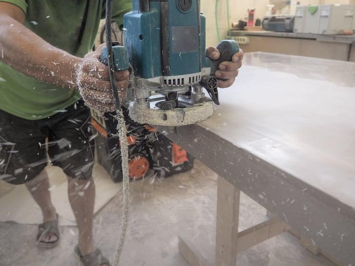 Worker sanding acrylic countertop