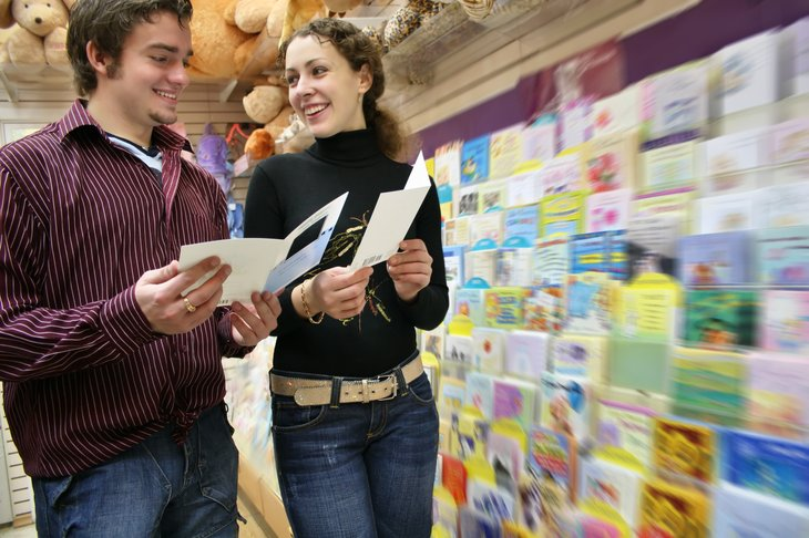 Couple shopping for greeting cards