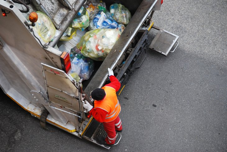 Garbage worker in truck, seen from above