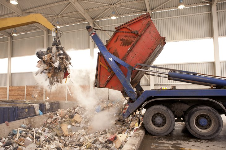 Garbage truck dumping its contents
