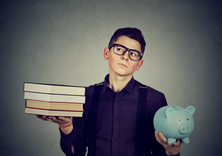 Student with books, piggy bank.