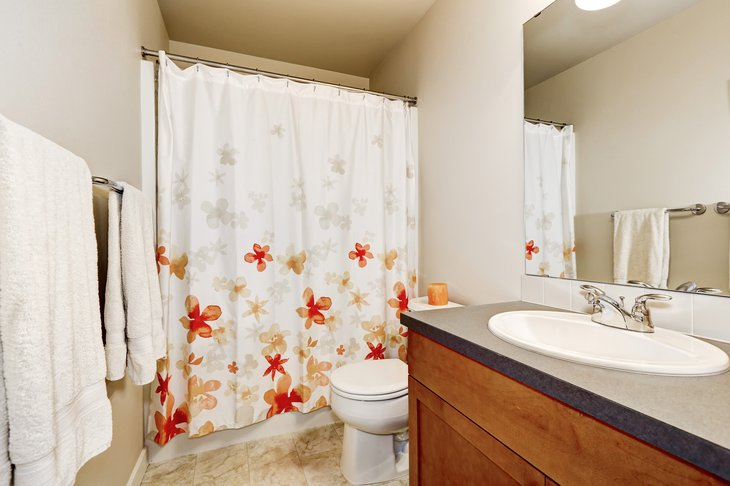 Bathroom with colorful shower curtain