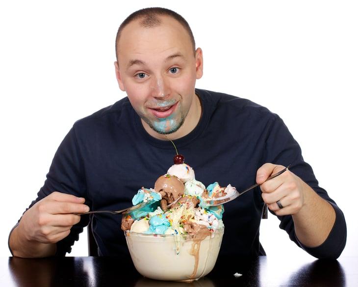 Man eating giant sundae