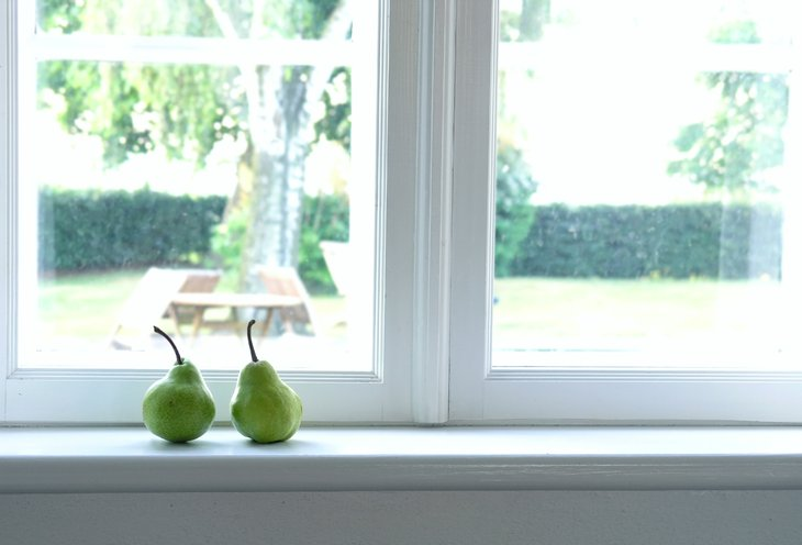 Pears on a window sill