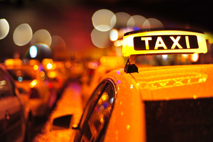 Taxi sign on car roof
