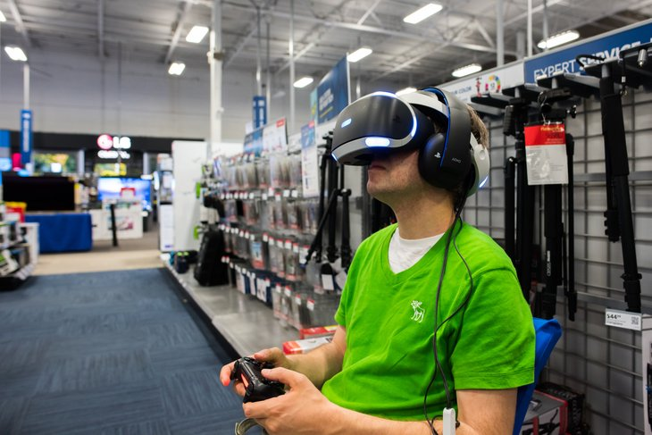 A man uses a virtual reality headset in a Best Buy store