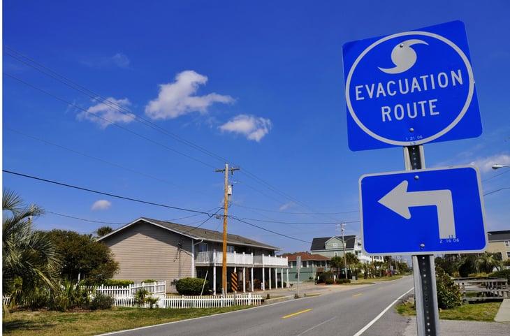 Evacuation route sign in South Carolina beach neighborhood.