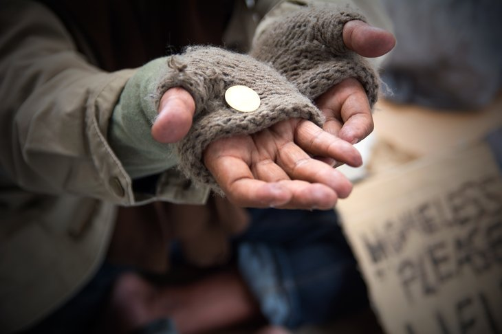 Hands of a homeless person begging.
