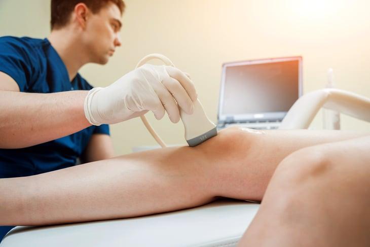 Sonographer examining patient's knee