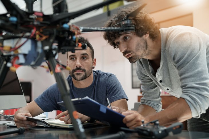 Engineers looking at drone