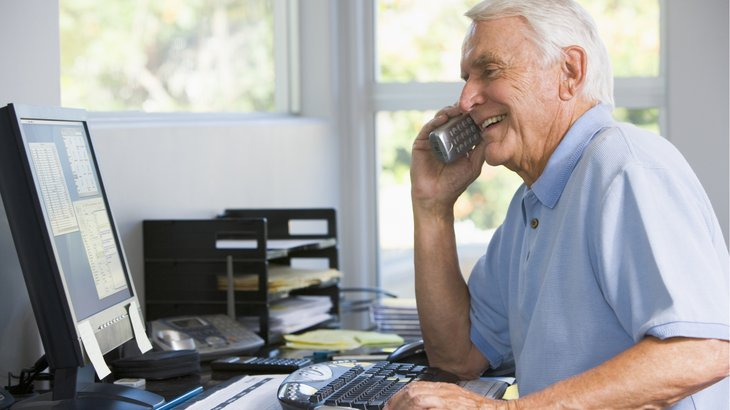 Older man working online