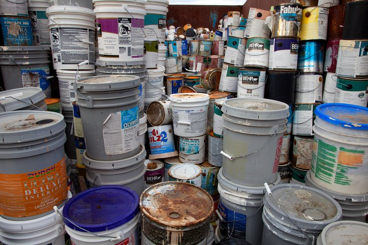 Stacks of used paint cans and other materials.