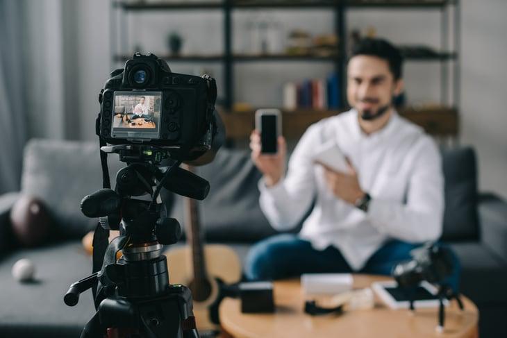 Man shooting a video blog