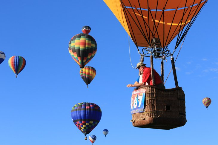 Senior man in hot air balloon